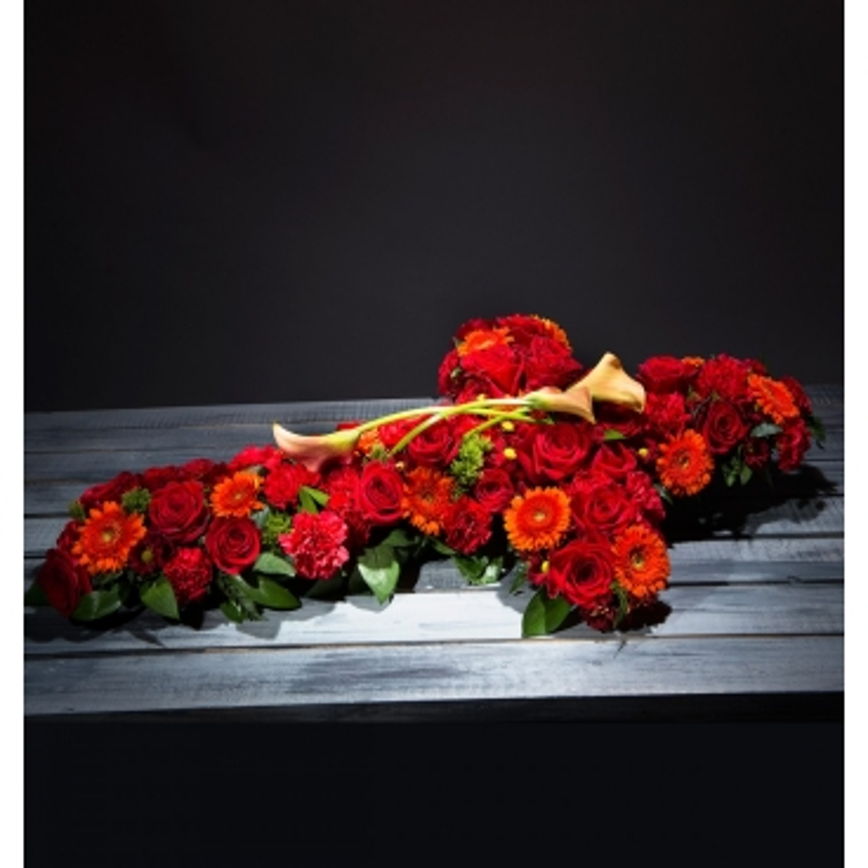 Cruz de flores funeraria